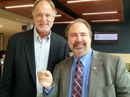 Wearing Baltimore Raven's Coach, Brian Billick's Superbowl Ring