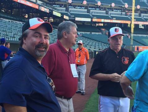 With Orioles Coach Buck Showalter on the field